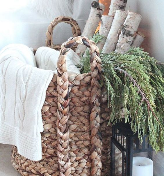 birch logs, greens and a throw in a basket