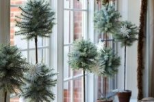 34 pale potted greenery and faux birds on a branch display