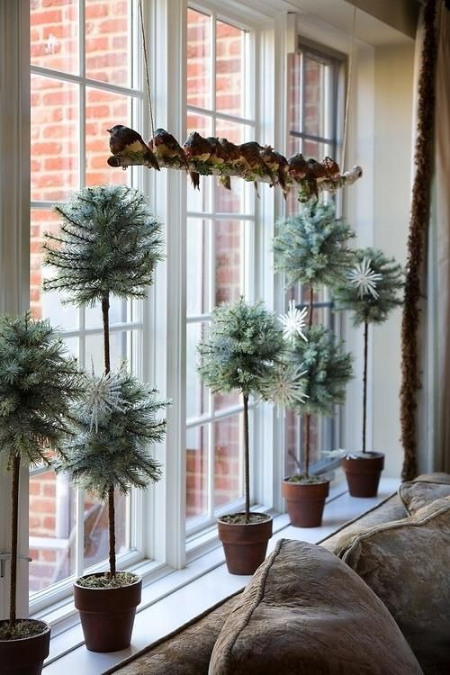 pale potted greenery and faux birds on a branch display