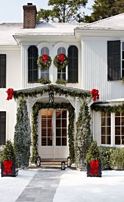 evergreen garland, trees and wreath with red bows