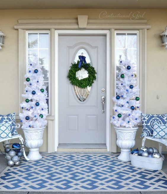 navy, blue and white Christmas porch decor with ornaments and white trees in urns