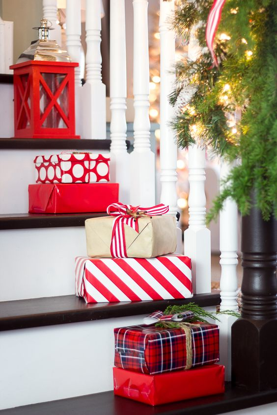 place gift boxes right on the stairs to bring a holiday vibe