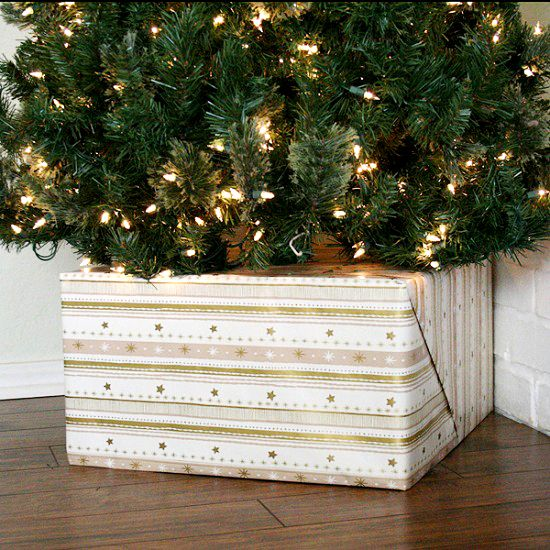 cover your tree base with a gift box for a glam look