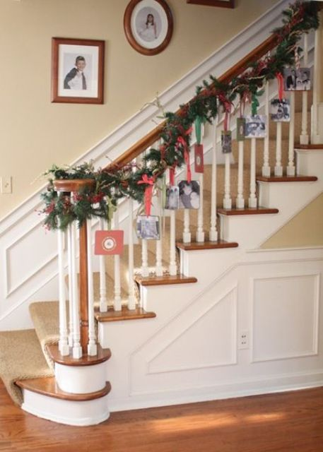 hanging cards on an evergreen garland with some ribbon