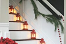 36 red lanterns placed on the stairs and an evergreen garland