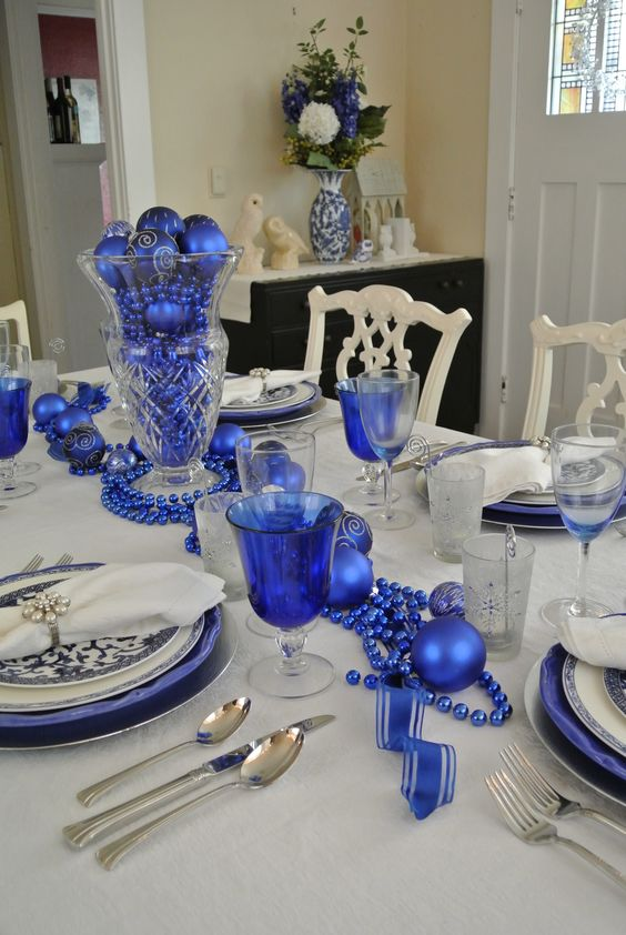 royal blue beads, ornaments and chargers for table decor
