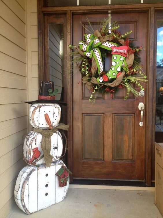 shabby snowman decoration made of reclaimed wood