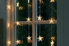 36 star-shaped light garlands on the window