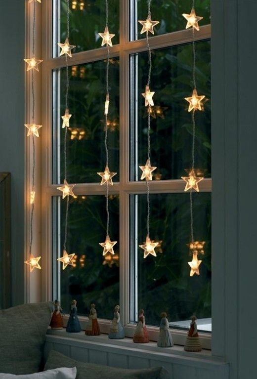 star-shaped light garlands on the window