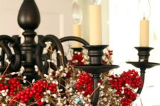 37 a mid-century modern chandelier covered with berries