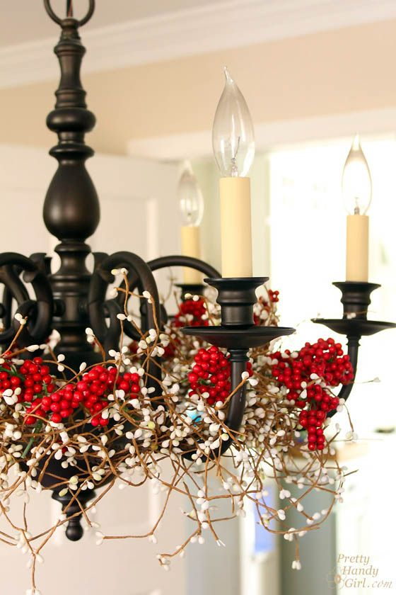 a mid-century modern chandelier covered with berries