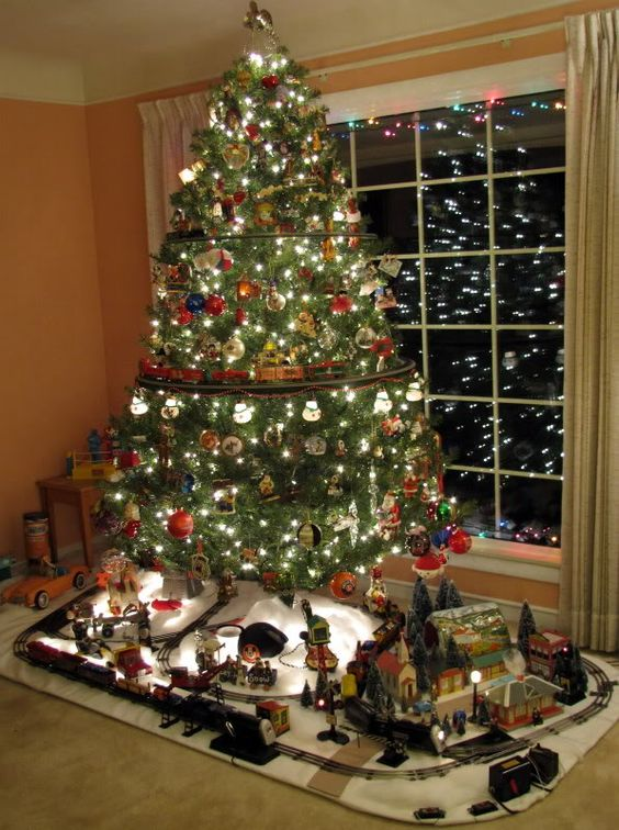 create a whole scene at the base of your tree to make the kids and adults happy