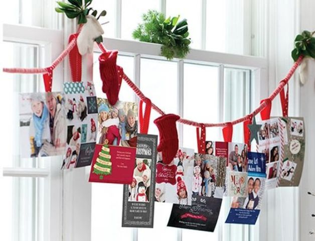 holiday card display on a garland with mittens