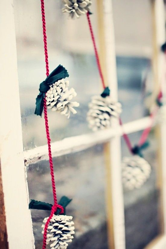 white pinecones on red strings for a simple and eye catchy garland