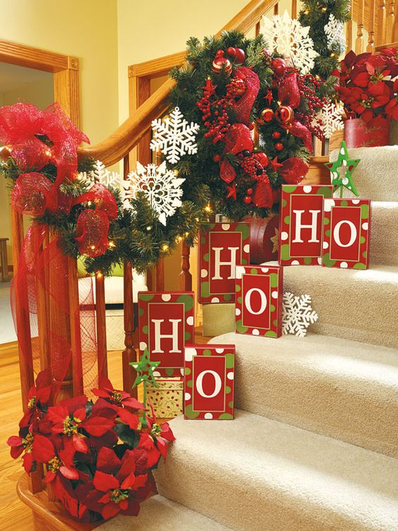 a bold garland and boxes placed right on the stairs