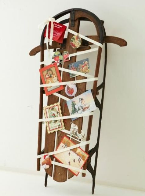 a vintage sleigh display with ribbon