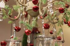 38 bottle brush trees in hanging glass votives, fir branches and red jingle bells