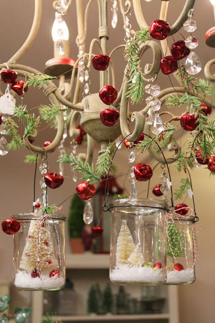 bottle brush trees in hanging glass votives, fir branches and red jingle bells