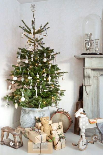 put an Xmas tree in a high pot so you can fit presents underneath without obscuring them