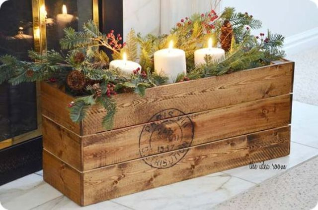 vintage crate filled with winter stuff for centerpieces and decor