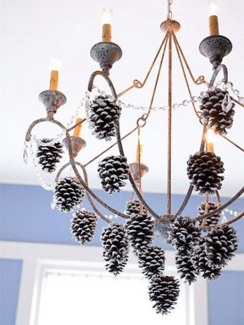 hang snowy pinecones on the chandelier