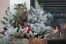 39 vintage crate with evergreens, pinecones, ornaments and berries