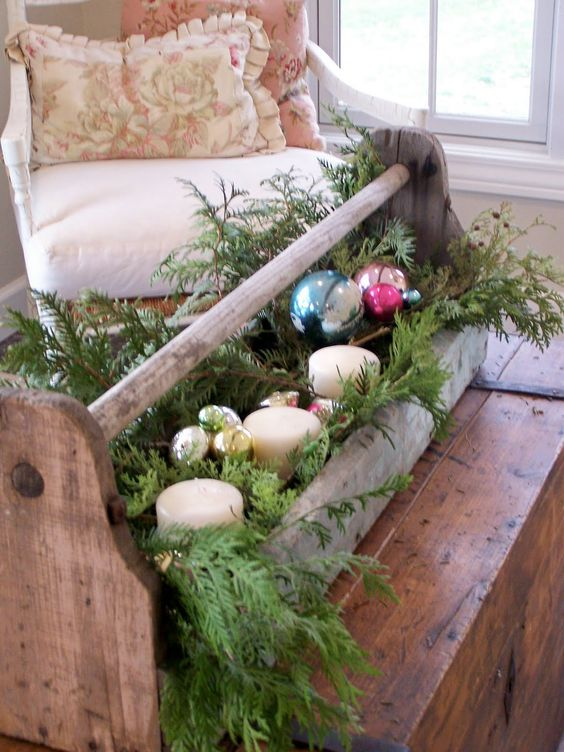 vintage toolbox repurposed for holiday decor with fir branches, candles and ornaments