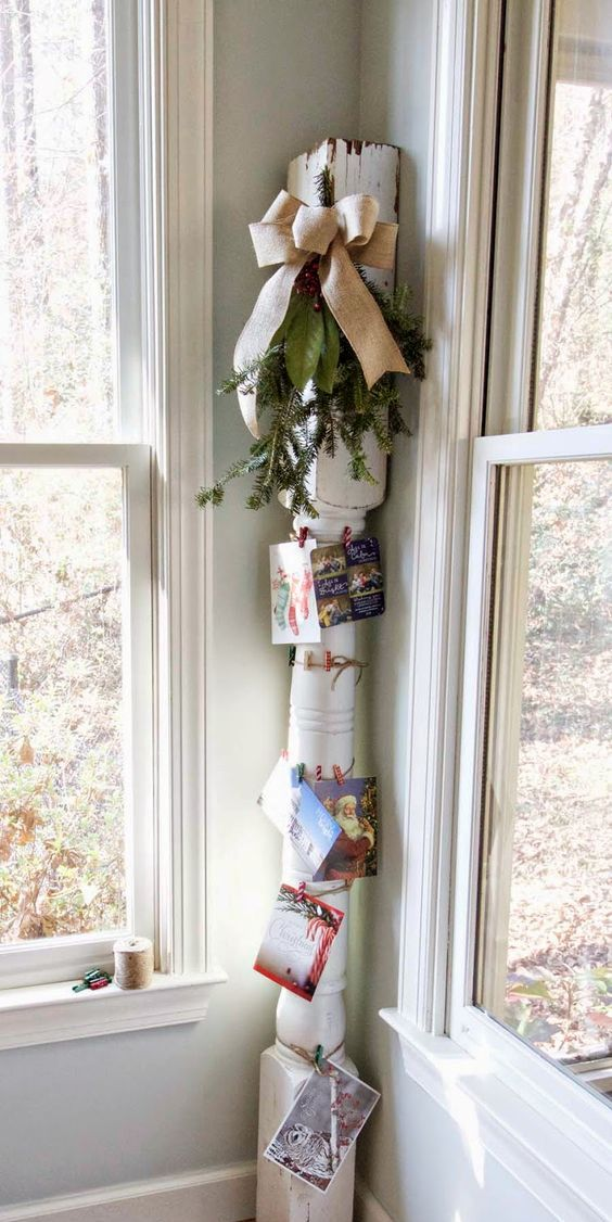 old house column tied up with string for ahnging pictures and cards