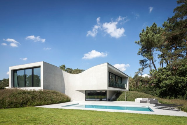 Villa MQ With Unique Sloping Architecture