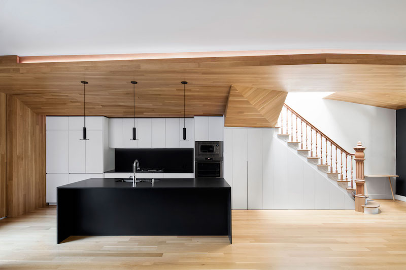 Black and white accents give the duplex a modern look, and lots of wood make it cozier and natural looking