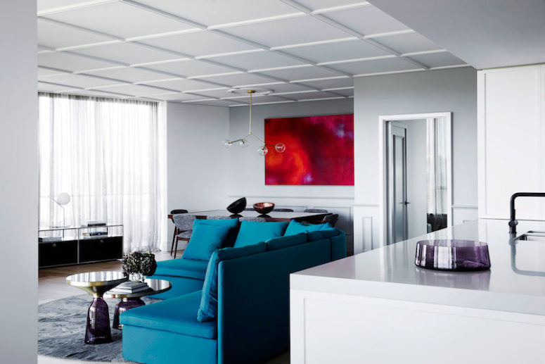 Brightly-colored focal points are scattered throughout the whole apartment