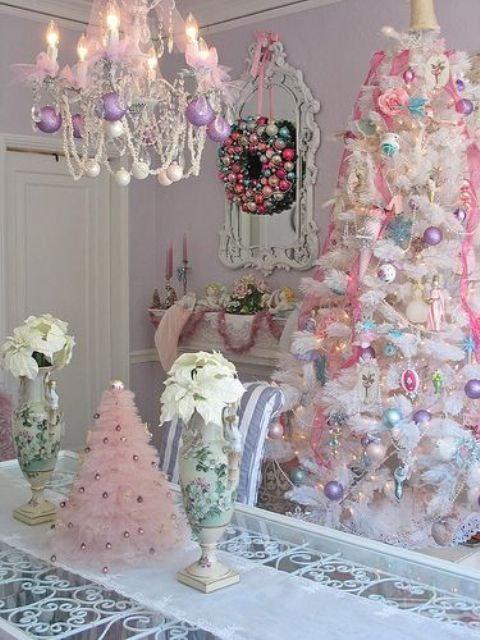 a white tree with pastel ornaments and a pink ruffle tree