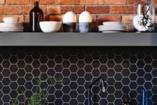02 black hex tile backsplash with white grout and exposed red brick to make your kitchen stand out