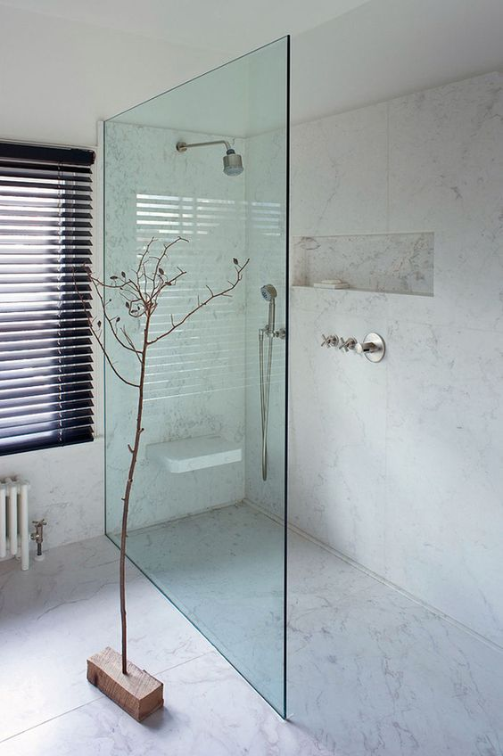 chic modern shower that seems one space with the bathroom