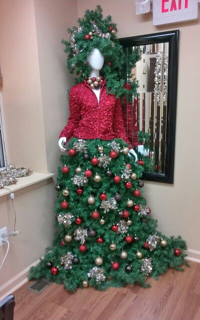 manequin christmas tree with a red jacket and a tree skirt