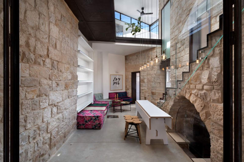 Glass and concrete used with ancient stone makes this house stunning and very eye catching