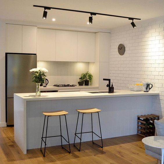 A Couple Of Track Lights Will Accentuate Your Kitchen Island Easily