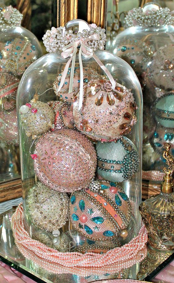 beaded, sequined and sparkled vintage ornaments in a cloche