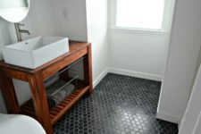 03 black hex tiles make a statement in this neutral bathroom