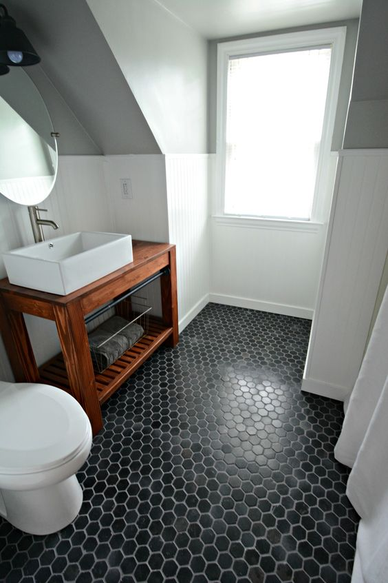 black hex tiles make a statement in this neutral bathroom. 39 Stylish Hexagon Tiles Ideas For Bathrooms   DigsDigs