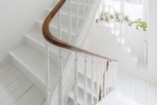 03 clean white staircase for a shabby chic feel and warm wooden handrail