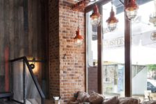 03 great copper lamps wrapped over the tables and brick clad