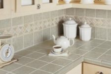 03 grey tiles on the backsplash and countertops with beige grout