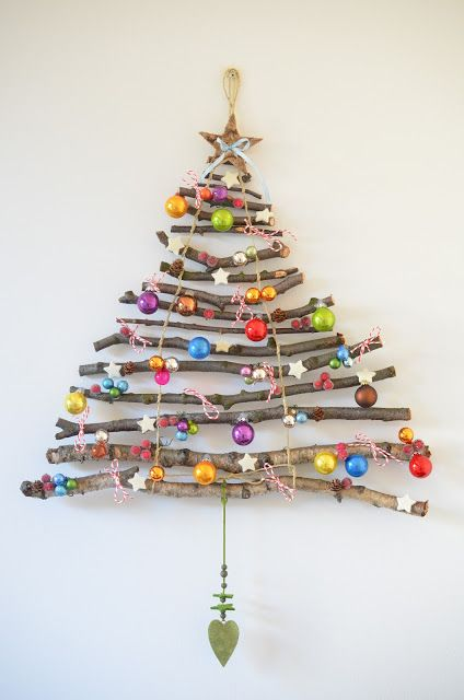 stick wall Christmas tree with colorful ornaments