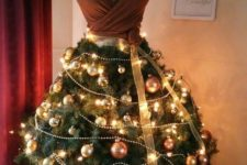 04 Christmas tree dress is a unique idea that is getting popularity