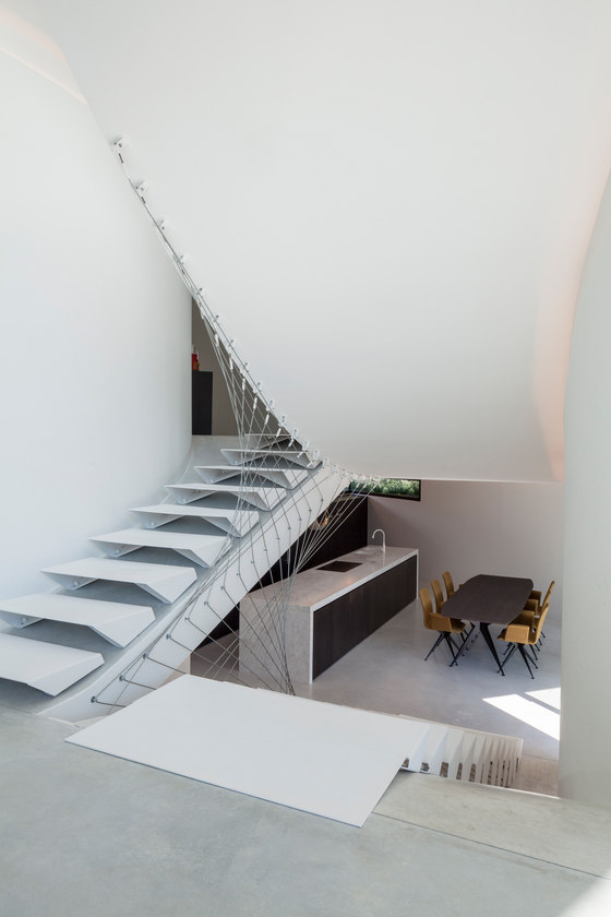 The ladder with geometrical design is one of the focal points of the house