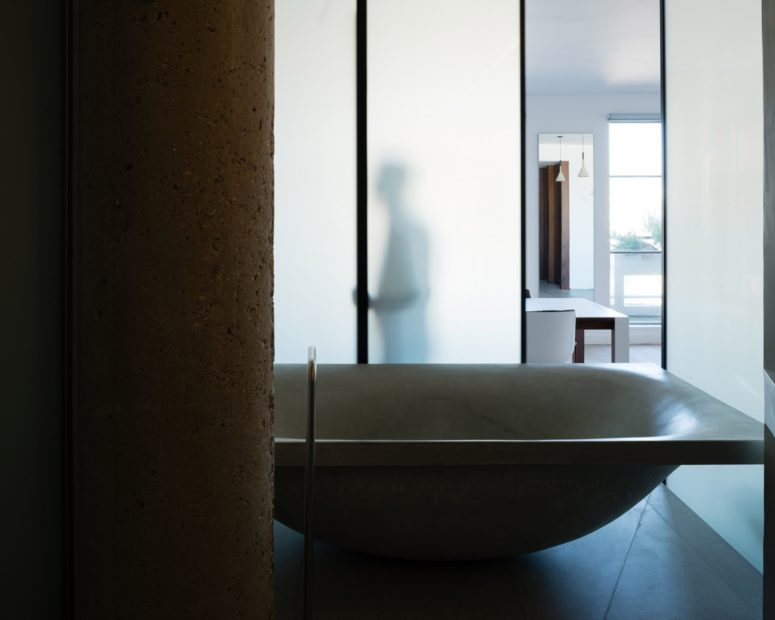 This is the unique sculptural bathtub, which is the focal point of the whole apartment