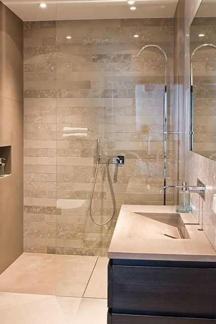 continuous floor with no lip or step into the shower makes the transition seamless - Walk In Shower Design Ideas
