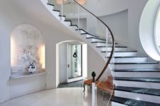 04 elegant glass balustrade with a wooden handrail