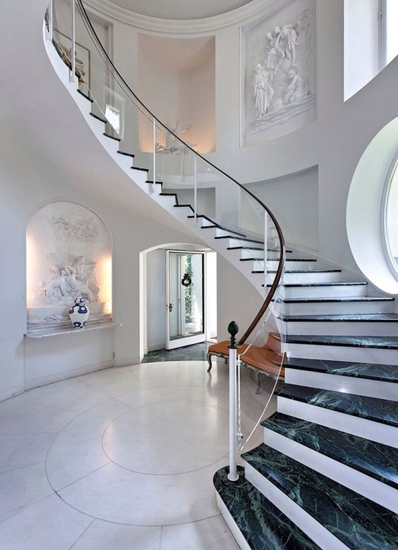 elegant glass balustrade with a wooden handrail